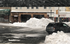 After 2 days of consistent snowfall (totaling 19 inches), snowbanks loomed over sidewalks in Morristown on February 3, 2021.