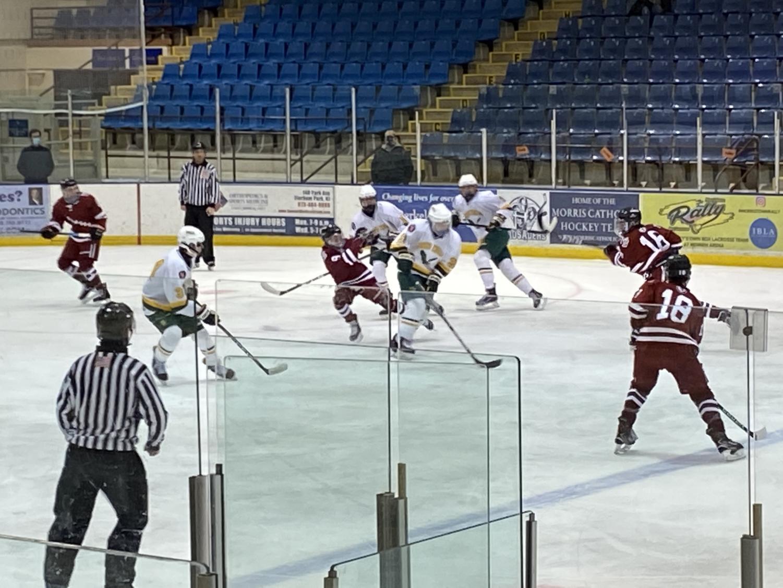 The varsity boys ice hockey team, lead by co-captains Cam Fernandez