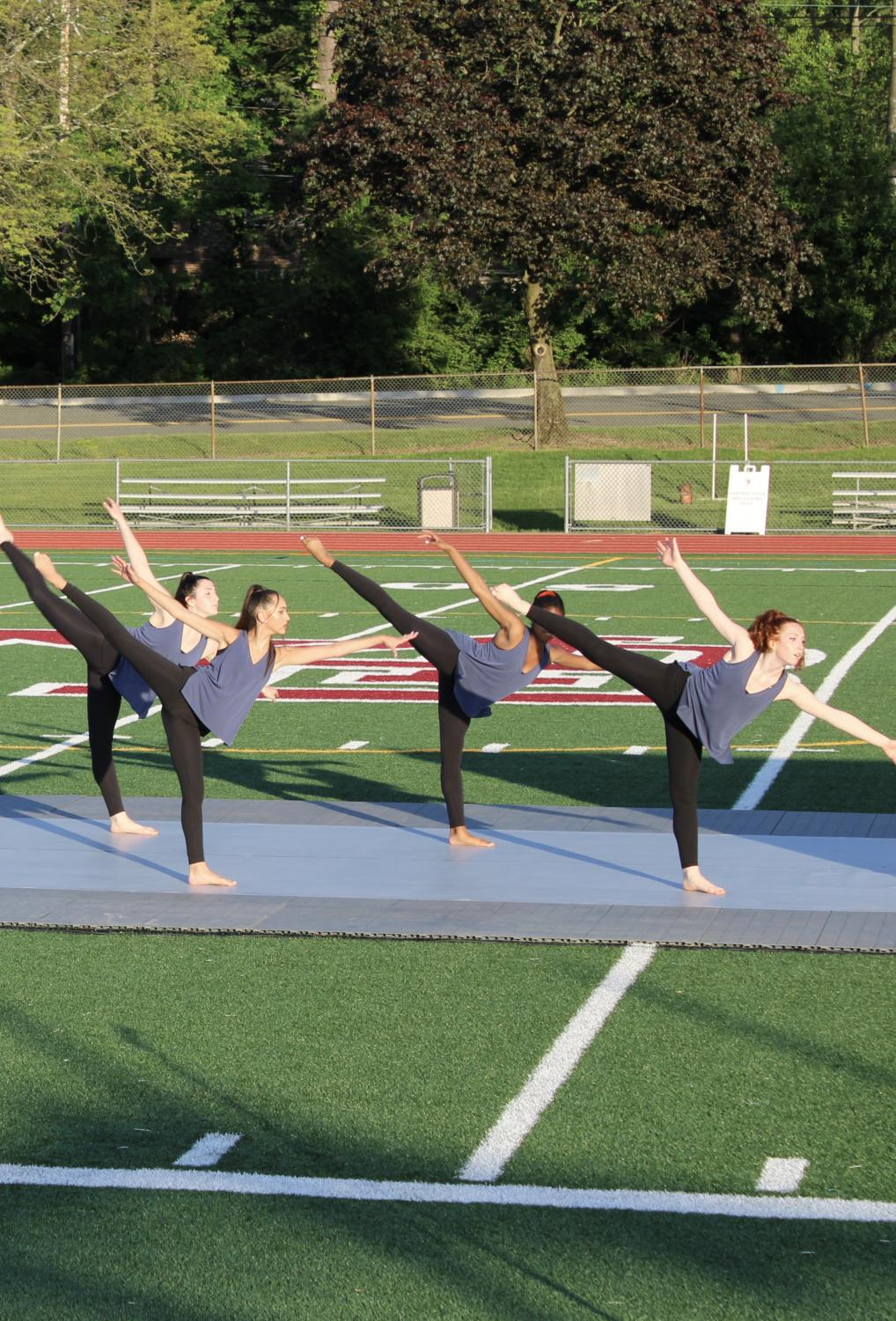 The MBS Dance Ensemble performs together on Burke Field.